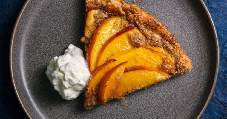 Slice of Peach Galette with whipped cream